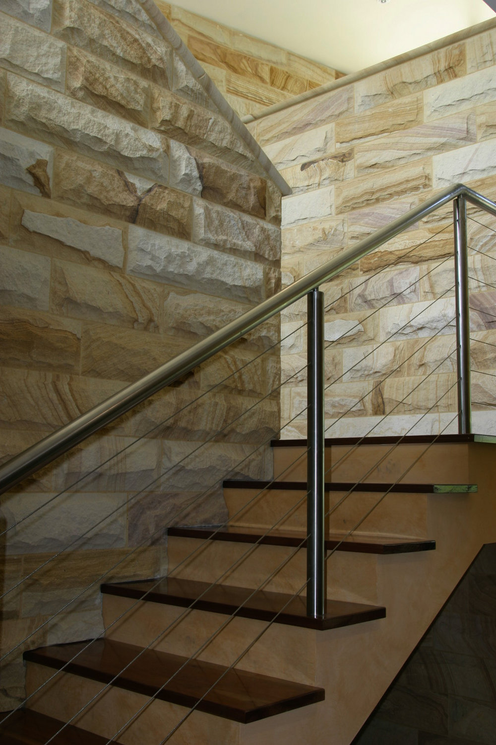 internal rockface cladding light-med brown staircase feature wall (7).JPG