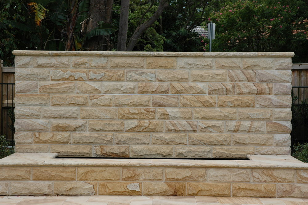 light-medium brown rockfaced cladding walling capping water feature -Artistry in sandstone.JPG