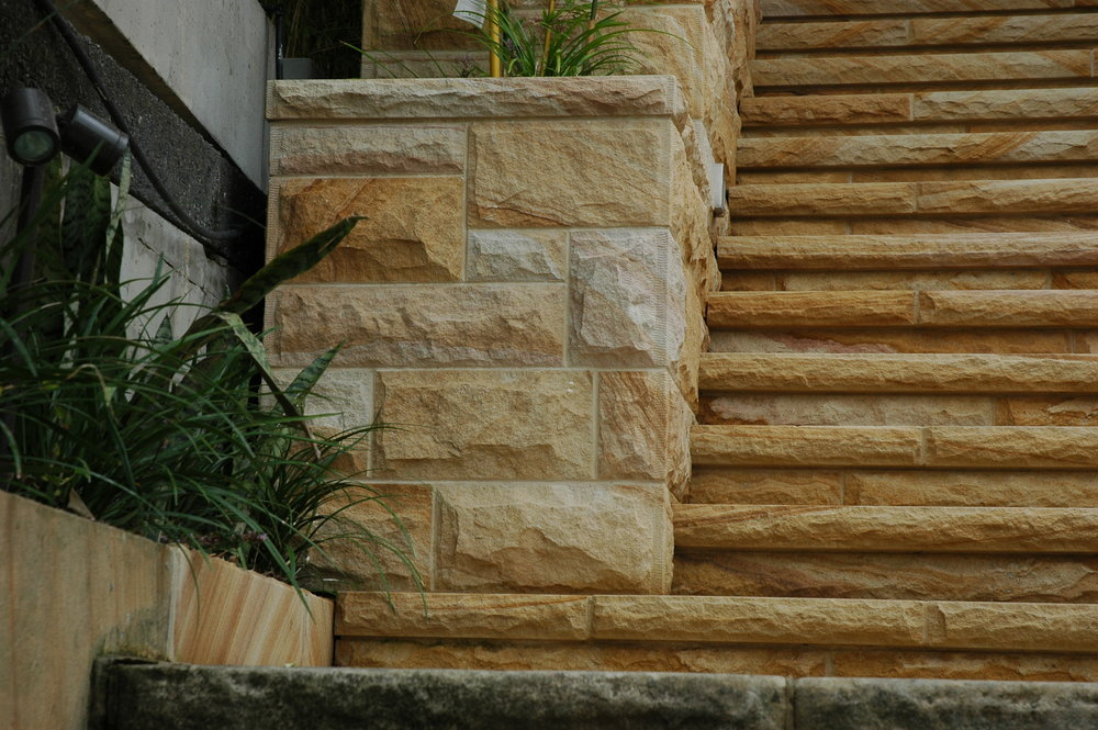 Medium Brown Random square rockfaced walling with tooled margin. Rockfaced step and riser detail-Artistry in sandstone.JPG