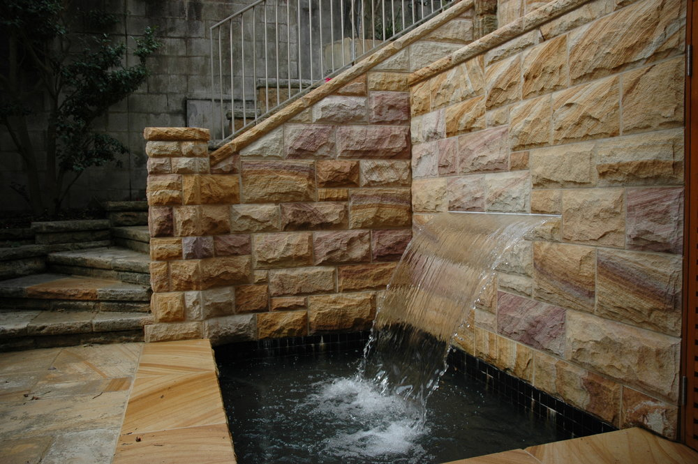 quarry run rockfaced random square walling water feature - Artistry in sandstone.JPG