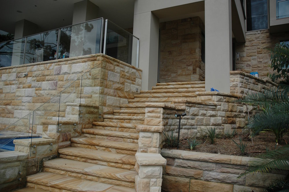 Artistry in sandstone light-medium brown rockfaced cladding, steps and pool surrounds retailing walls (12).JPG