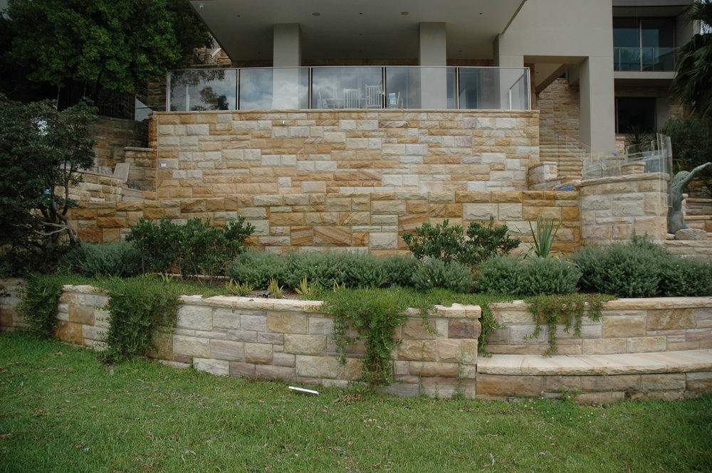 Artistry in sandstone light-medium brown rockfaced cladding, steps and pool surrounds retailing walls (13).JPG