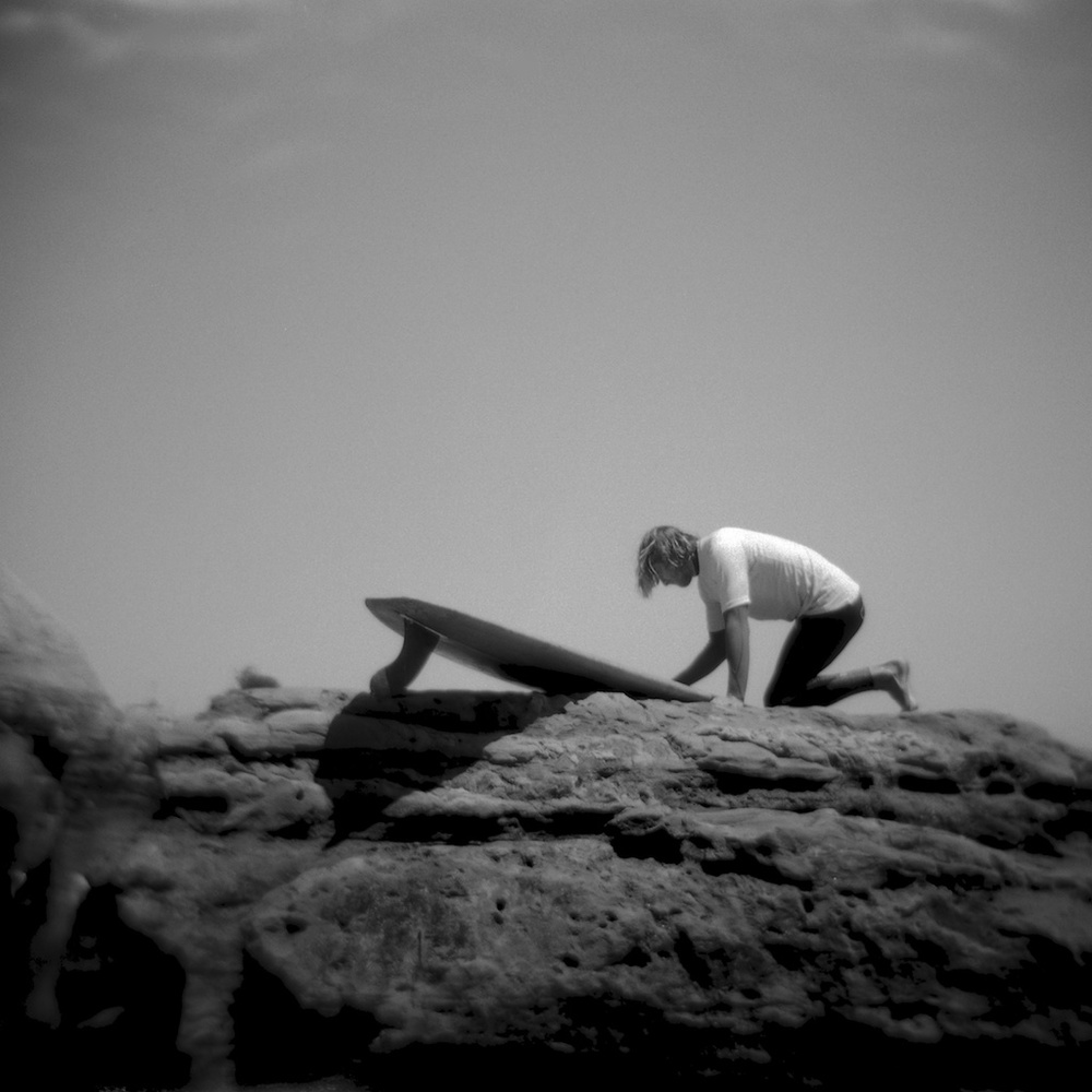 [#037709] Waxing his board, Logjam 2013, Santa Cruz, USA, 2013