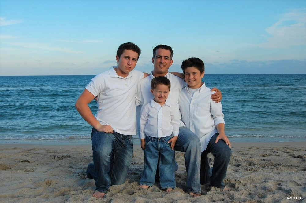 Family Photo Shoot On The Beach. Photography By James Knill