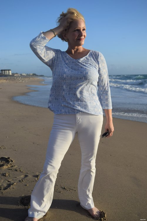 Portrait Of A Lady On The Beach. Photography By James Knill
