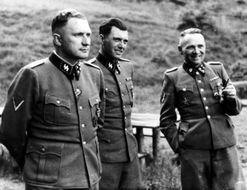 """Dr. Josef Mengele (middle) the """"Angel of Death""""."""