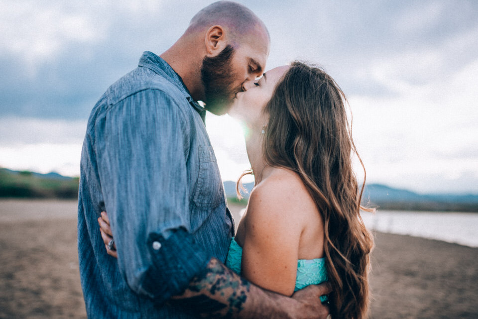 Standley Lake denver wedding photographer engagement session passionate kiss