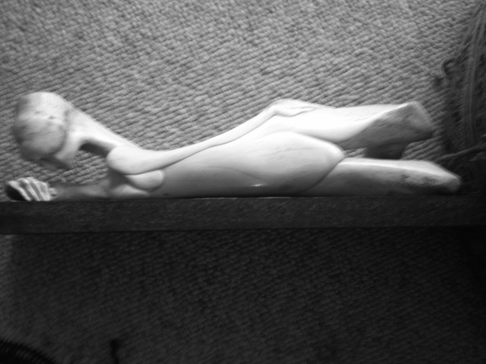 Reclining Female Nude - Bone Sculpture by Jerry Hardin