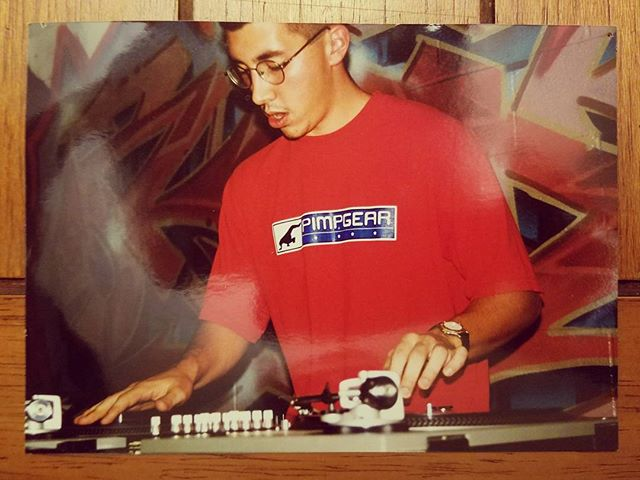 Pimpgear?! I'm sure it was a free shirt.  I would have to guess this is 1998 or close to it. This was during a dj battle where I was concentrating so hard that I had no control of my mouth. It happens. #realdjing