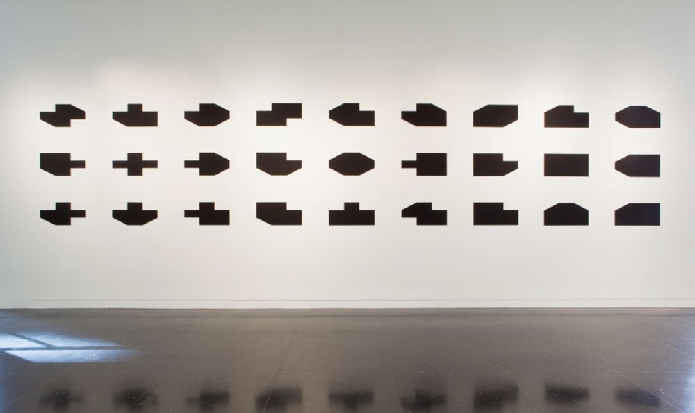 "Object into Symbol , 1999 – 2012,  Paint on aluminum panels. 5 ft. 4. in x 31 ft. An arrangement of all the shapes between a rectangle and a cruciform shape that can be made by subtracting corner triangles. In 2012 show ""Figures and Grounds"" at The Arts Club of Chicago, guest curator Anne Rorimer. Revision of 55 Mercer Gallery version (1999). Next installation will have small adjustments."