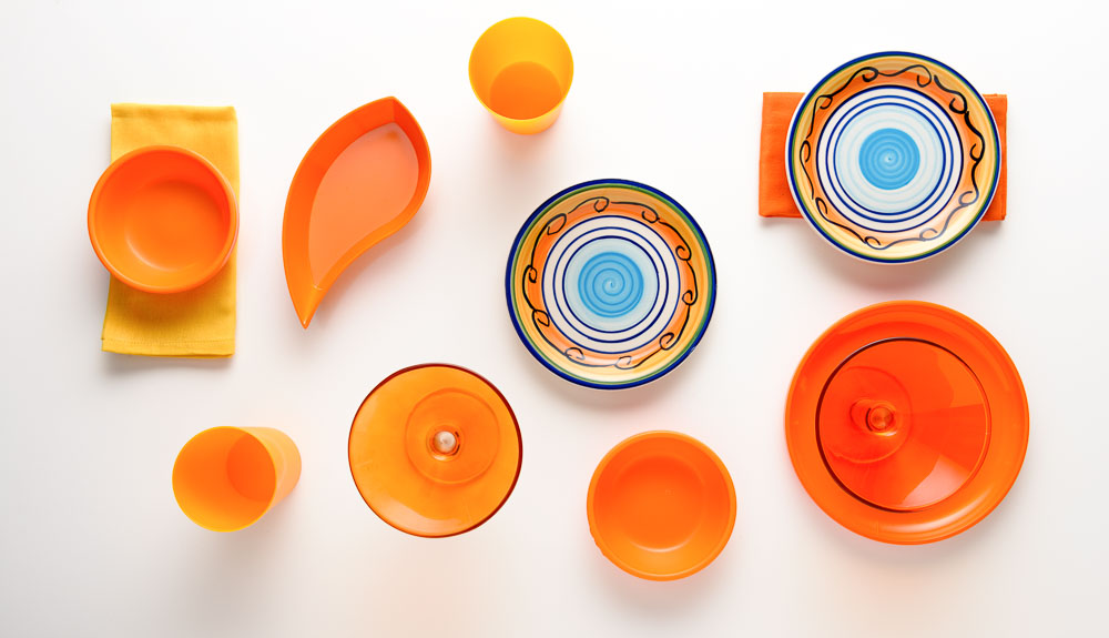 Arrangement of Orange Plates, Bowls, Cups and Glasses