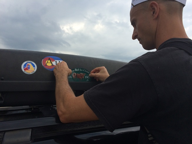 Ken - adding another sticker to the cartop carrier.