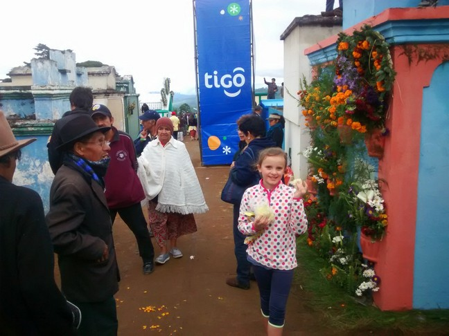 Elle is always happy with cotton candy in her hands! Love the decorated grave marker and erected advertisement for Tigo, a local cell phone company.