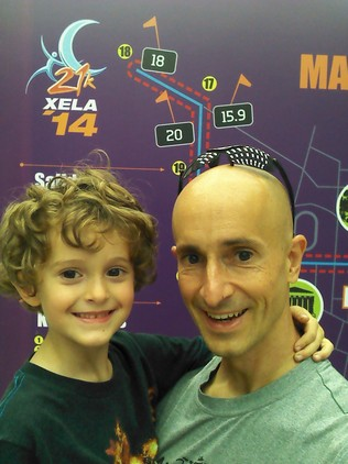 Tag and I at the expo in front of the race map.