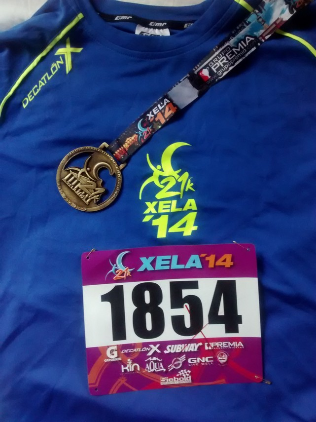 My tech shirt, bib and finishers medal.