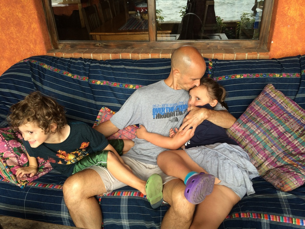 A little cuddling and wrestling on the couch back at La Iguana before it's dinner time.