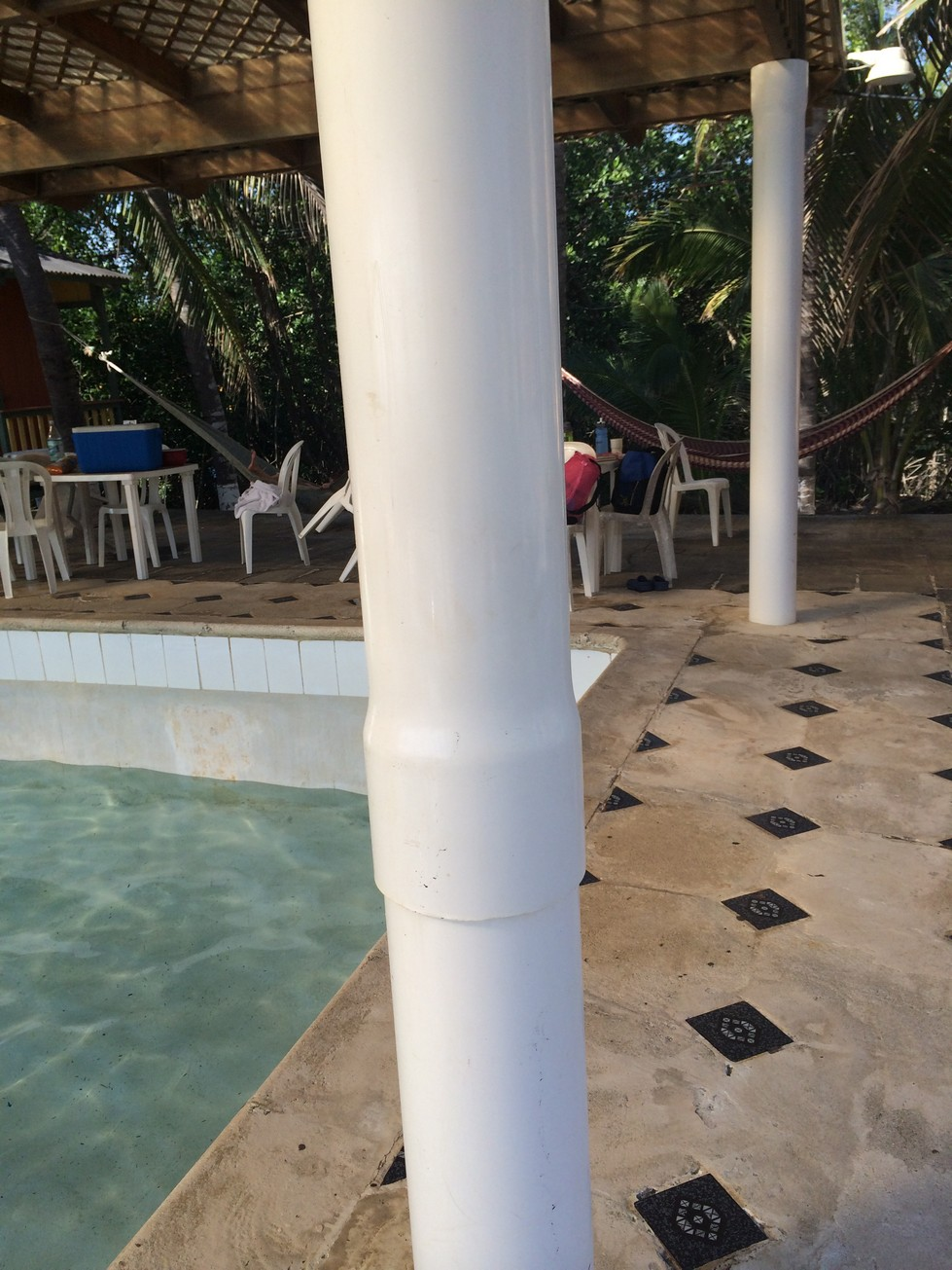 The poles holding up the pool shelter (PVC).