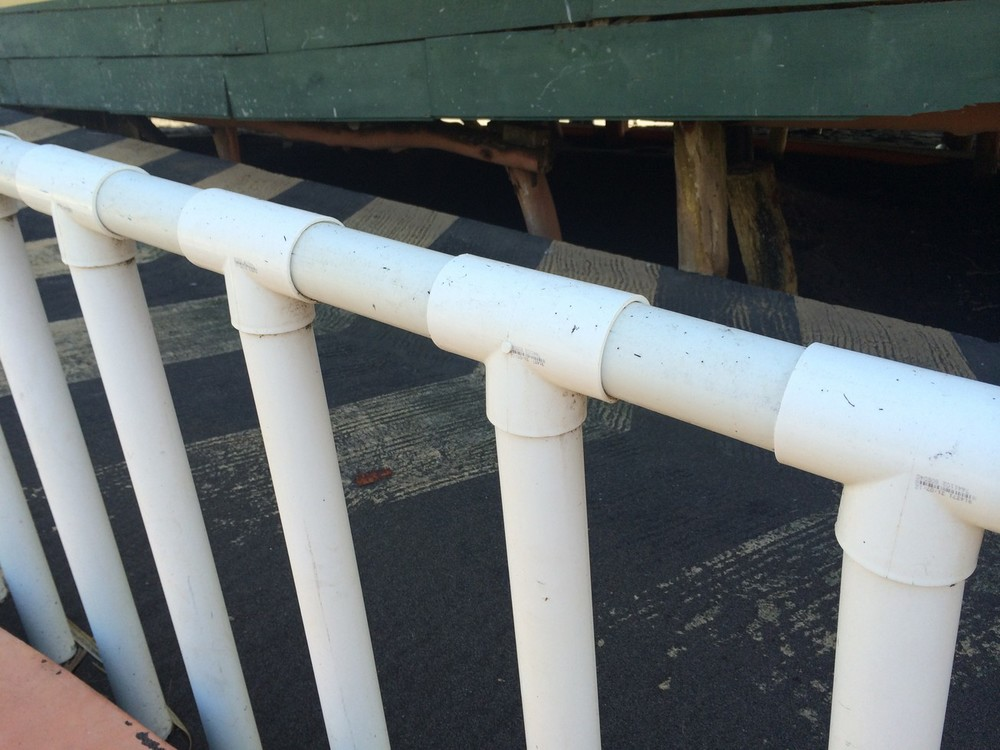 The railing up the wheelchair ramp (PVC).
