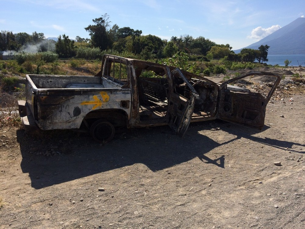 The scorched remains of the truck near the shores of the lake.