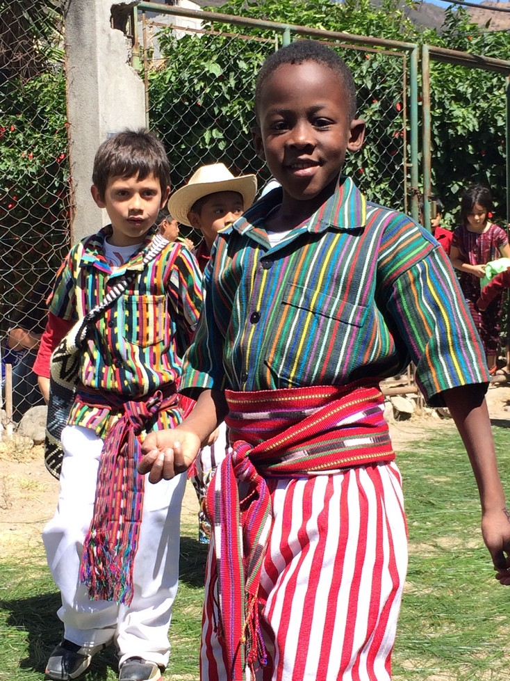 Traje is quite colorful. I've only started to appreciate the colors and the designs and let go of my feelings about matching stripes with stripes or vertical stripes with horizontal stripes. The kids were adorable, and I'd love to see Tag wear clothes like this every day.