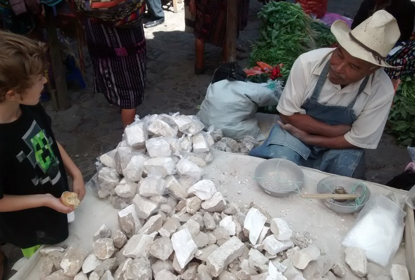 This farmer is selling bags of limestone rocks for Q3 (about 39 cents US). The rocks are used for cleaning. Tag thought thiat was cool!