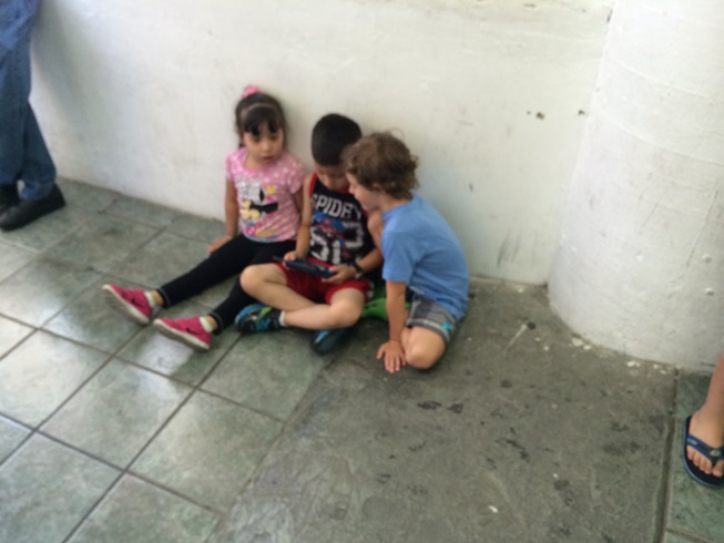This pic was taken at the border in Mexico. My son knew no Spanish but did not hesitate to saddle up next to two other kids in order to watch a video game.