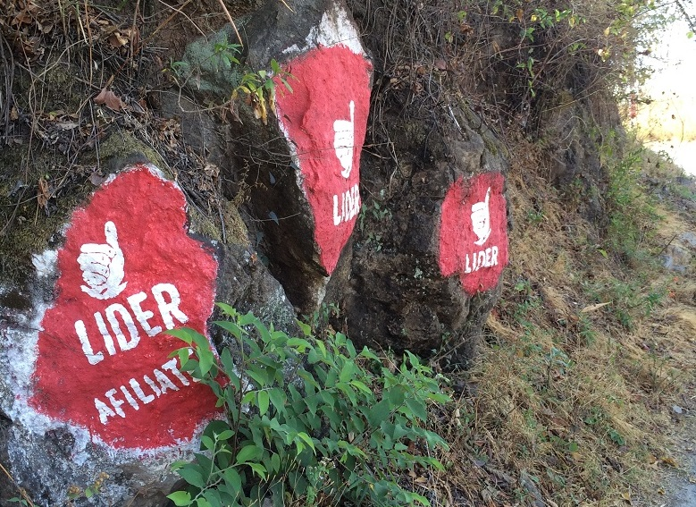 Political parties and candidates use boulders like these to advertise along the road.