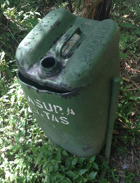 The top of an old gas can was cut off to create a trash can with a lid