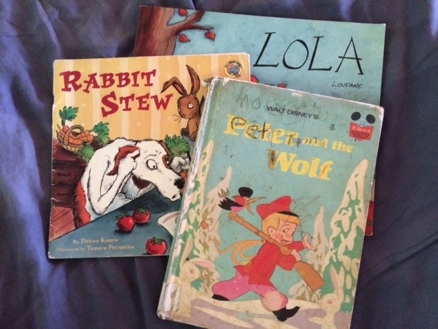 I knew Tag would love these books when I found them in the used book store. Ken has read Rabbit Stew at least 30 times this summer. Tag is now reading Peter and the Wolf to himself. Guns, wolf hunting...of course Tag would love the book, no matter how much the book had already been loved by another.