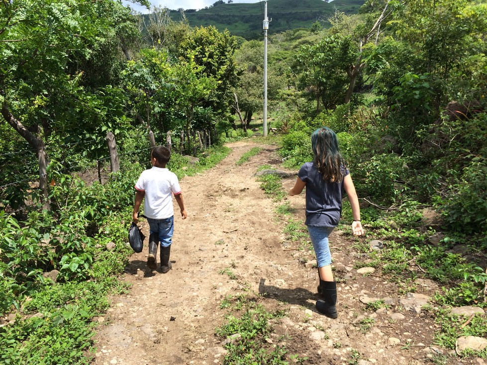 "This is one of my favorite pictures of Ela. She was so happy this entire weekend. She loved walking in the fields, playing with the kids and enjoying a ""real life Social Studies lesson"". This is what life is like for many Nicaraguan families."