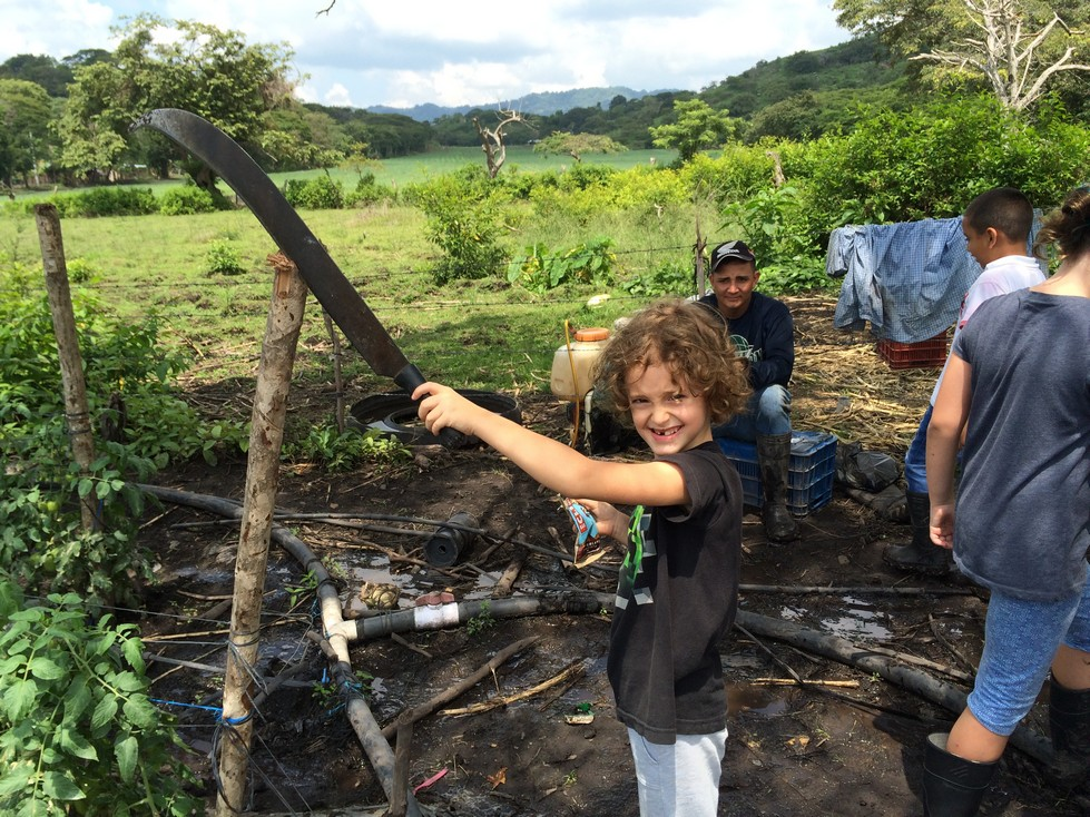 Of course Tag was drawn to Juan's brother's machete. This child has a knack for finding weapons.