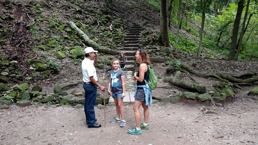 Raul, giving the family a brief overview of the ruins.