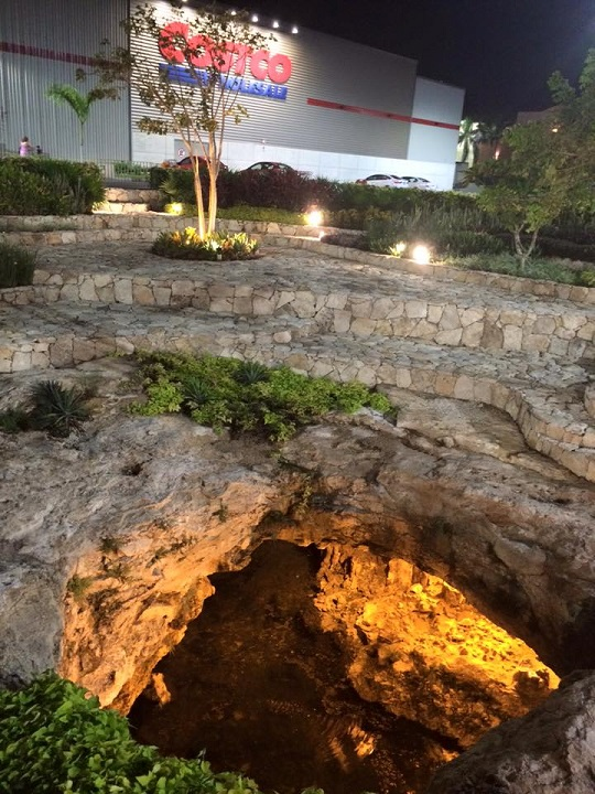 A cenote in the parking lot.