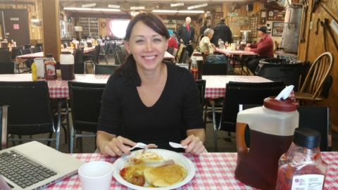 Siobhan enjoying some fine local cuisine, including maple syrup sucked directly from the trees outside at mclachlan family maple syrup farm in komoka ontario.  the jug of syrup would unfortunately not fit in her carry on luggage.