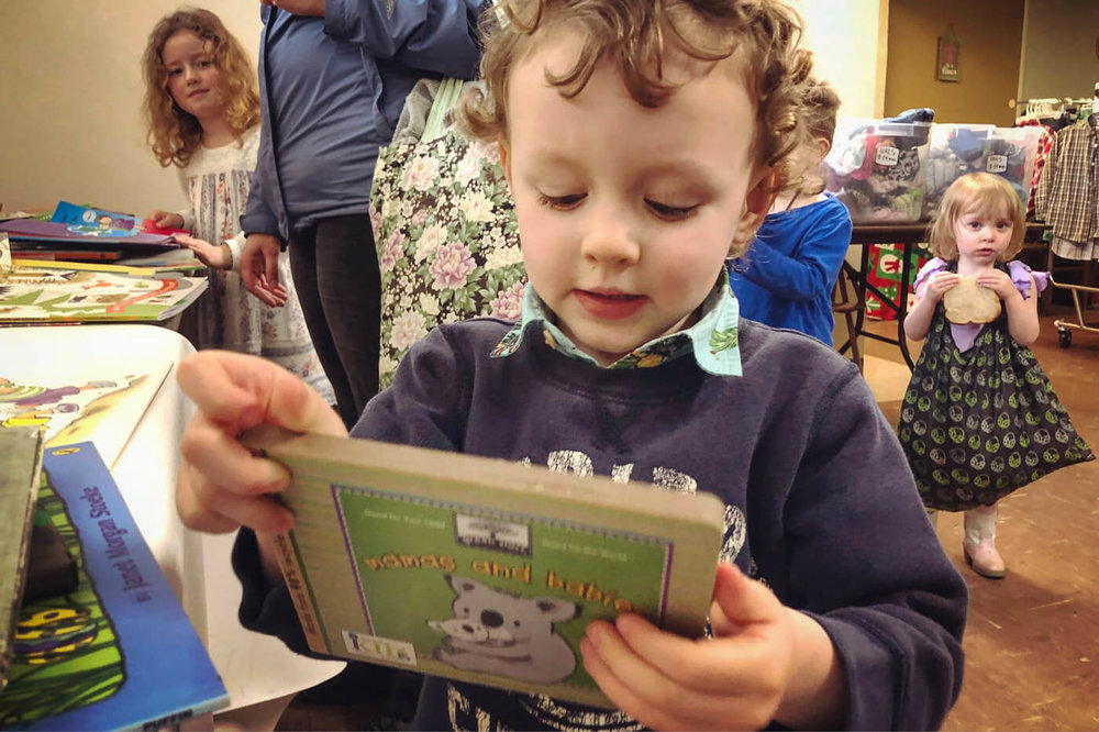 For the first time ever we added books to the exchange…and it was big hit with the little readers. While their parents looked for new clothes, kids picked out new books to call their own. We hope to expand and offer a greater selection of books for grown ups in the future. A huge thanks to the   Children's Book Bank   for getting us started and sharing our love for reading.