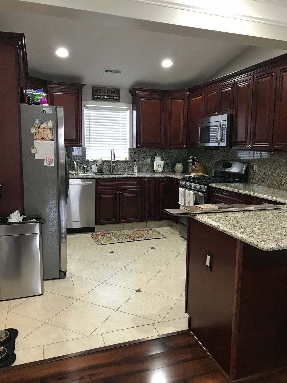 Dark flooring, dark cabinets