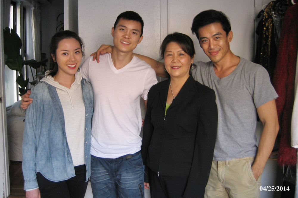 Director Leon Le and the cast during a prop photo session.
