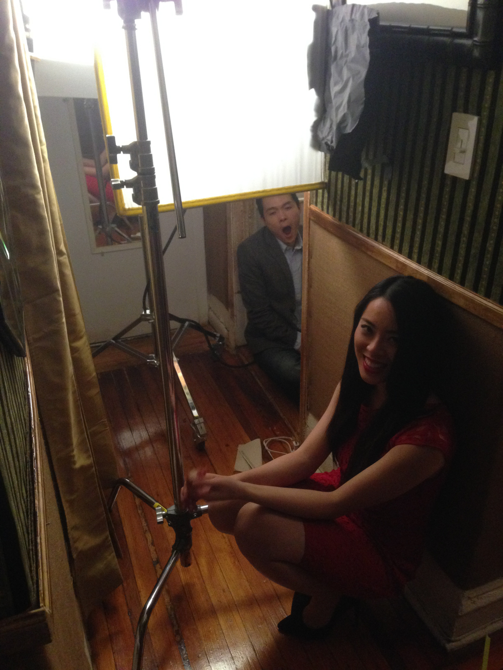 Actress Charis Chu (Julianne) shows that she's a pro, still smiling on set at 4 am waiting for her scene.