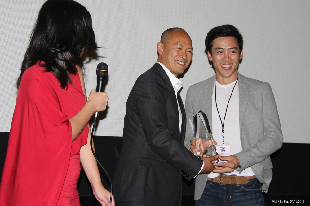 Director Leon Le accepting the Trong Dong award for Best Short Film at the Viet Film Fest 2015.