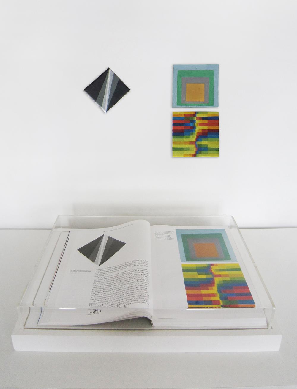 Páginas 70 e 71 (Série Foi Assim Que Me Ensinaram) •2012 •Livro emoldurado, óleo sobre tela •23,5 x 34,7 cm (livro), 6 x 6,5 cm, 9 x 9,5 cm, 9,7 x 9,2 cm