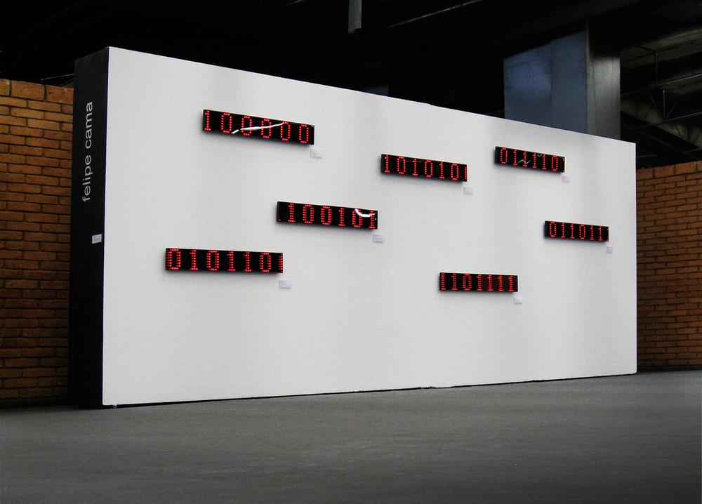 Acervo •2007 •Sete imagens digitais decodificadas em displays luminosos LED, sete etiquetas de identificação• 13 x 90 cm (cada display), 5 x 10 cm (cada etiqueta) •Coleção de Arte da Cidade de São Paulo