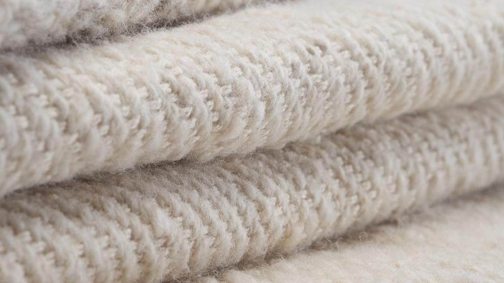 Woven throws using homespun Kenyan wool. Now on line.