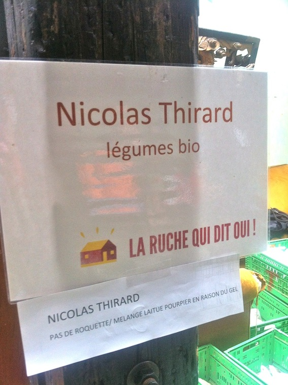 "Sign at Nicolas Thirard's stand, ""No roquette or lettuce due to frost"""