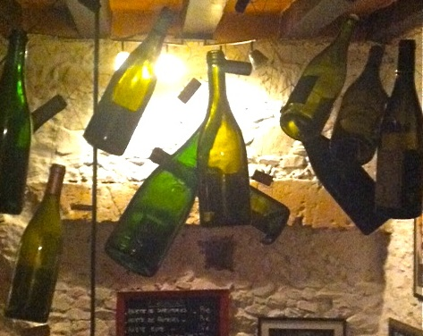 Suspended bottles at Le Cercle Rouge in Angers