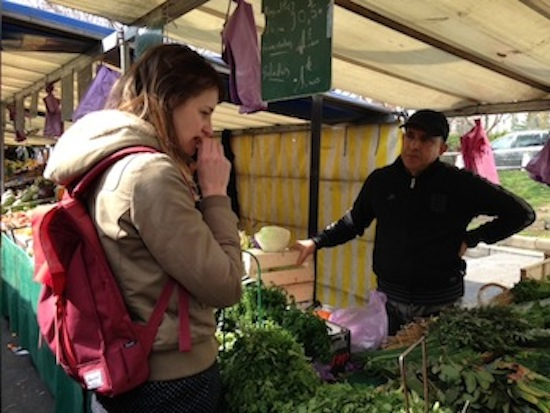 Tasting fresh herbs at the market