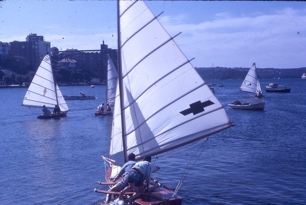VJ's launching from DBSC. Resplendent with wooden hulls, hiking planks, cane battens and metal centreboards.