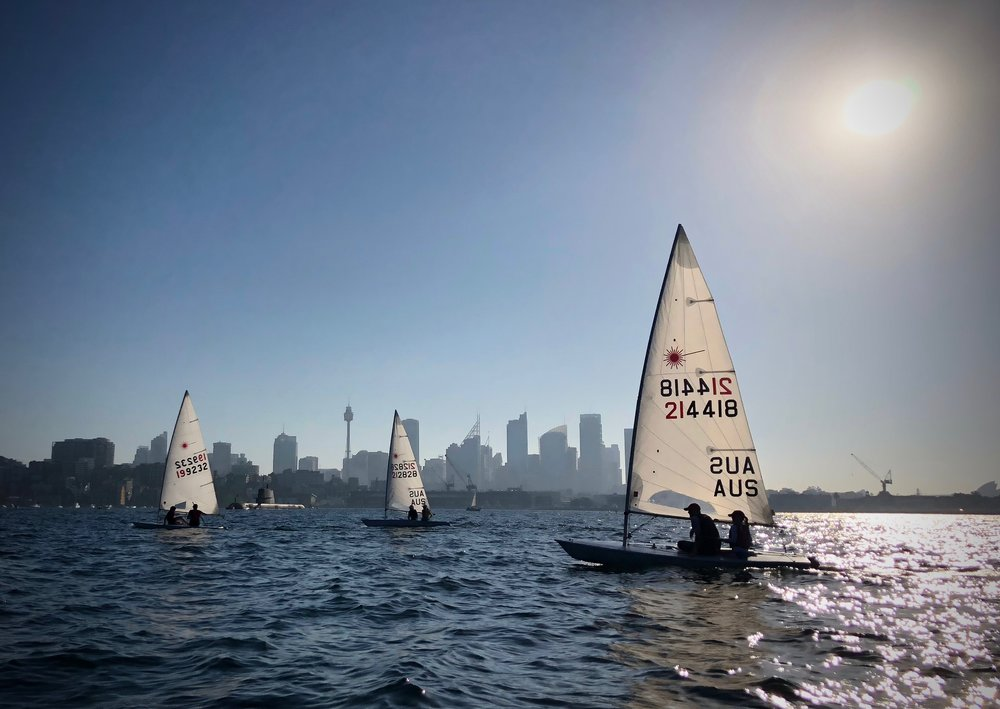 A rare sight in Sydney Harbour -- 3 lasers, 6 sailers, 1 sub.
