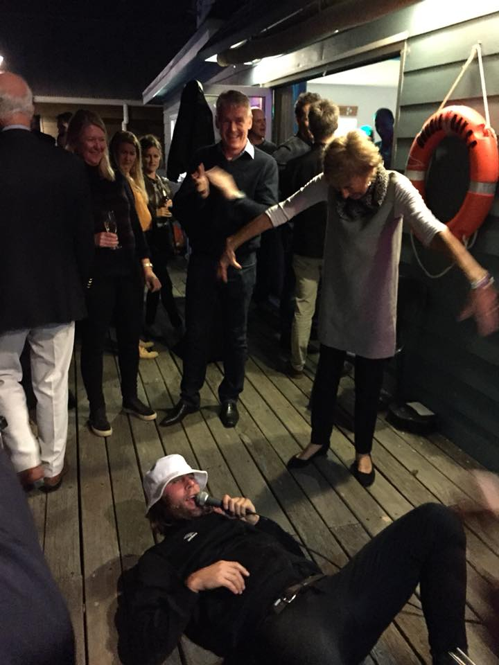 The Party Spills onto the Deck.  Photo by Nick Pellow