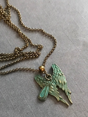 "wings and a tear #0118 $20 length of brass chain is 30""."