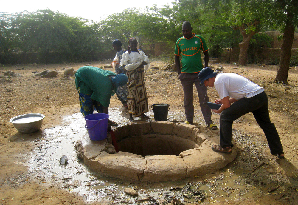 Interviewing the Songhai people at a well to learn about water usage.